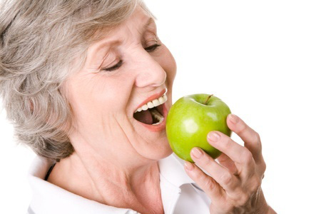 mature-woman-eating-apple